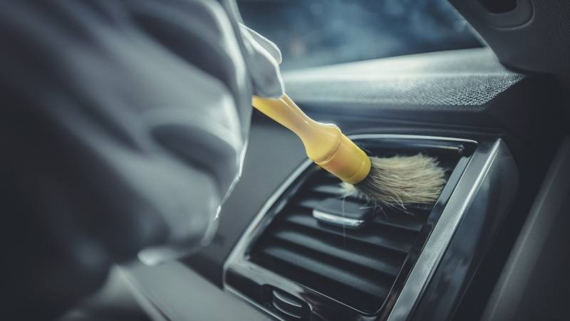 brushing air vents in a car