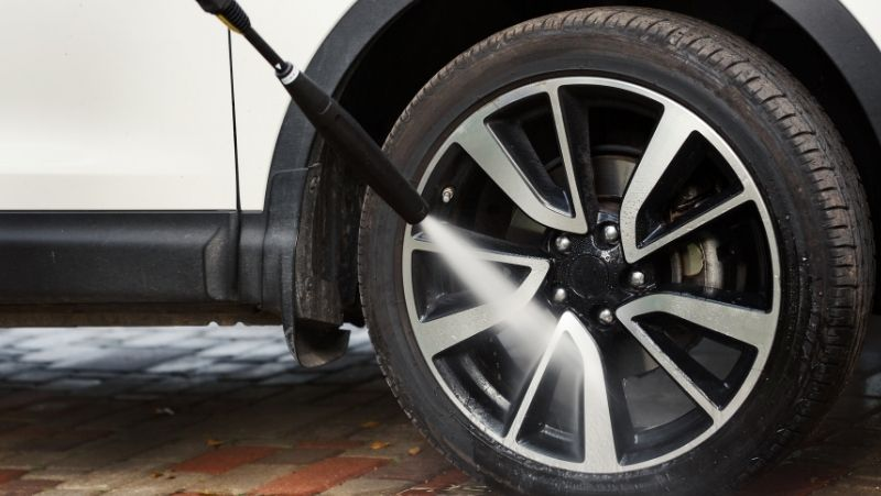 pre-rinsing car wheels and tires