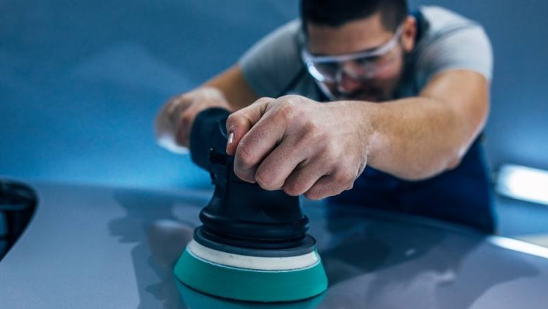 is polishing necessary after claying your car, man polishing the car, car detailing planet