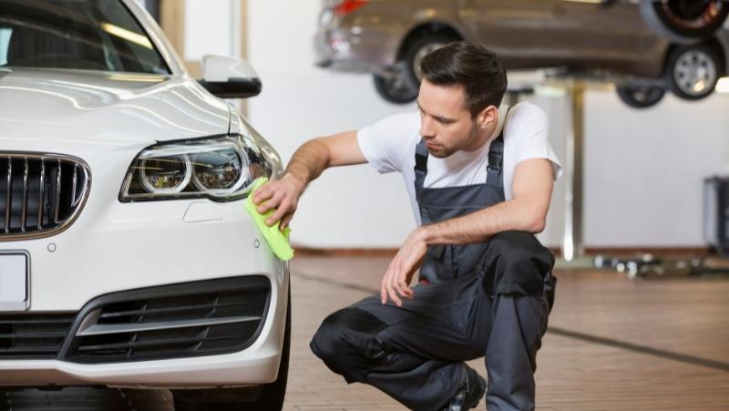 man cleaning car, steps after claying the car,