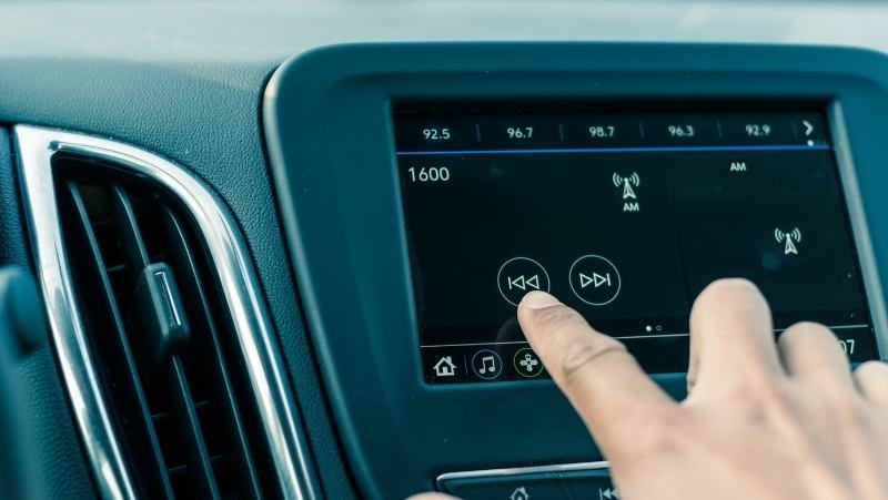 car infotainment system, touchscreen in car, fingerprints car screen, cleaning car radio,