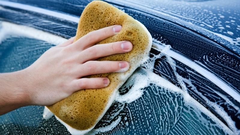 washing car with a sponge
